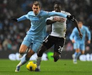 Manchester City's Bosnian striker Edin Dzeko (left) during a match against Fulham in February. Bayern Munich are lining up a bid for Dzeko in the hope of partnering the Bosnian with their top scorer Mario Gomez, according to a report on Thursday