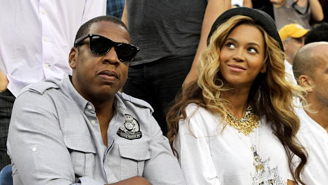 **File Photo**  Beyonce and Jay-Z have welcomed their first child - a baby girl called Blue Ivy Carter, according to eonline.com.  Jay Z and Beyonce Novak Djokovic of Serbia plays against Rafael Nadal of Spain during the Men's Final on Day 15 of US Open Tennis Tournament, on Arthur Ashe Stadium, in Flushing Meadows, Queens, New York.   New York City, USA - 12.09.11 Mandatory Credit: HRC/WENN.com, Credit: WENN.com
