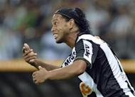 Ronaldinho of Brazil's Atletico Mineiro reacts during the Copa Libertadores second leg final soccer match against Paraguay's Olimpia in Belo Horizonte, July 24, 2013. REUTERS/Pedro Vilela/Files