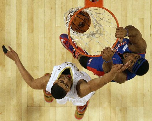 Team Hill's Andre Drummond of the Detroit Pistons (0) dunks the ball against Team Webber's Anthony Davis of the New Orleans Pelicans during the Rising Star NBA All Star Challenge Basketball game, Friday, Feb. 14, 2014, in New Orleans