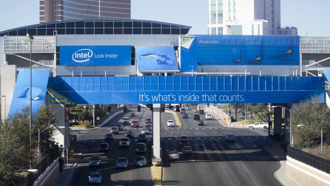 Traffic passes under monorail station covered by an advertisement from Intel for the 2014 Consumer Electronics Show (CES) near the Las Vegas Convention Center in Las Vegas