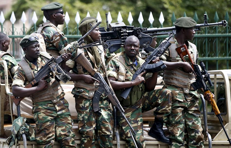 Soldiers hold their weapons in Bujumbura