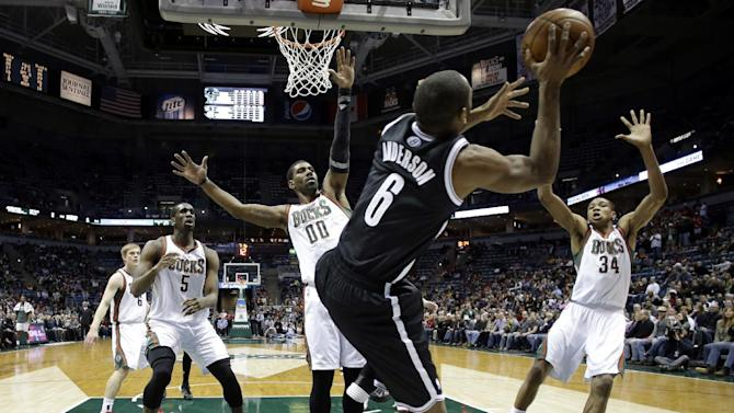 Brooklyn Nets' Alan Anderson tries to pass the ball before landing out of bounds during the first half of an NBA basketball game against the Milwaukee Bucks Saturday, Dec. 7, 2013, in Milwaukee