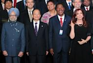 L to R: India's Prime Minister Manmohan Singh, China's Premier of the State Council Wen Jiabao, Benin's President Boni Yayi and Argentina's President Cristina Fernandez de Kirchner pose during the UN Conference on Sustainable Development Rio+20 family photo, in Rio de Janeiro, Brazil