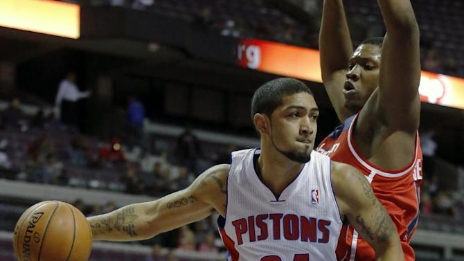 Detroit Pistons guard Peyton Siva (34) passes the ball against Washington Wizards forward Kevin Seraphin during the second half of a preseason NBA basketball game Tuesday, Oct. 22, 2013, in Auburn Hills, Mich. The Pistons defeated the Wizards 99-96