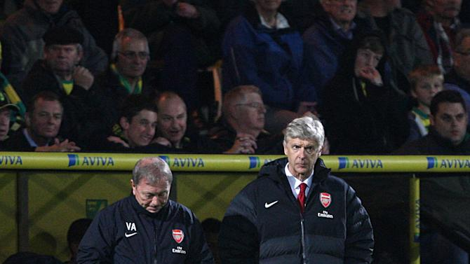 Arsene Wenger, right, hopes the defeat at Norwich will 'have a positive impact' on Arsenal