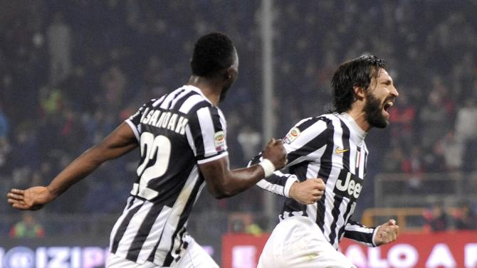 Juventus' Pirlo celebrates with his team mate Asamoah after scoring against Genoa during their Italian Serie A soccer match in Genoa