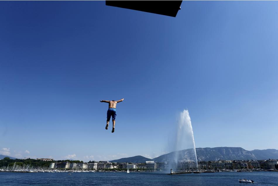 A teenager jumps off the diving platform of Bains des Paquis in Geneva