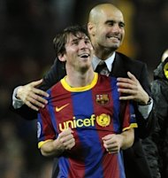 Barcelona's coach Josep Guardiola (R) celebrates with forward Lionel Messi after a Champions League match in 2011. Guardiola, architect of one the greatest eras in the club's history, has announced he is leaving the club at the end of the season