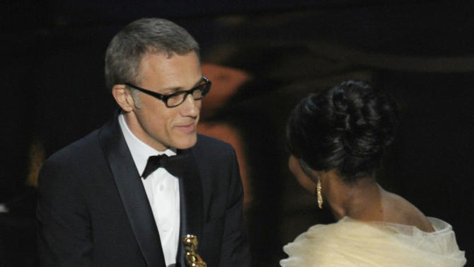 "Actress Octavia Spencer, right, presents the award for best actor in a supporting role for ""Django Unchained"" to Christoph Waltz during the Oscars at the Dolby Theatre on Sunday Feb. 24, 2013, in Los Angeles.  (Photo by Chris Pizzello/Invision/AP)"