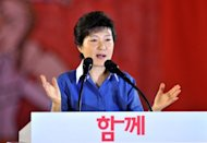 "The ruling party candidate in South Korea's presidential election apologised Monday for human rights abuses during the repressive rule of her late father, military strongman Park Chung-Hee. Park Geun-Hye (pictured in August) offered her ""sincere apologies to those who suffered and were wounded during this period, and to their families."""