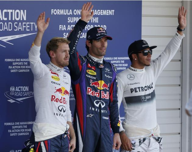 Vettel of Germany, Webber of Australia and Hamilton of Britain wave after the qualifying session of the Japanese F1 Grand Prix at the Suzuka circuit