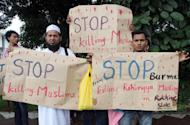 Myanmar's ethnic Rohingya Muslims display placards near the British embassy in Kuala Lumpur on July 19. Myanmar on Monday told a UN rights envoy it rejected accusations of abuse by security forces in the wake of communal unrest, after the United Nations raised fears of a crackdown on Muslims