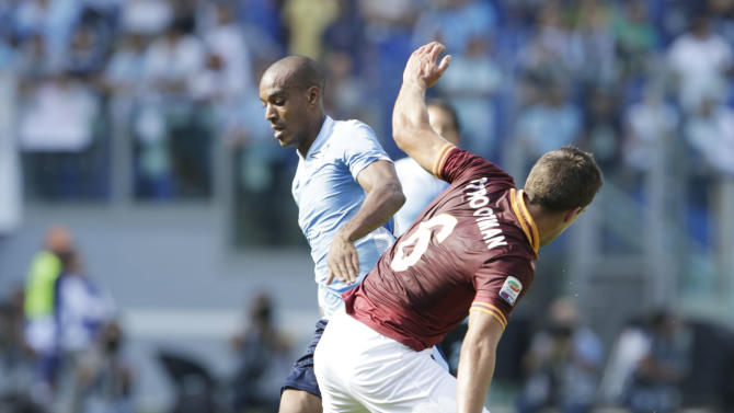 Lazio defender Abdoulay Konko of France, left, and AS Roma midfielder Kevin Strootman of The Netherlands fight for the ball during a Serie A soccer match between As Roma and Lazio, in Rome's Olympic stadium, Sunday, Sept. 22, 2013