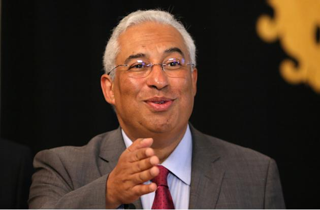 FILE - In this Friday, Nov. 20, 2015 file photo, Portuguese Socialist Party leader Antonio Costa talks to journalists after a meeting with President Anibal Cavaco Silva, at the Belem presidential pala