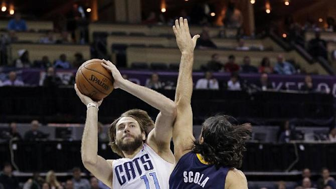 Charlotte Bobcats' Josh McRoberts (11) shoots over Indiana Pacers' Luis Scola (4) during the second half of an NBA basketball game in Charlotte, N.C., Wednesday, Nov. 27, 2013. The Pacers won 99-74