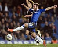 Chelsea's Spanish midfielder Juan Mata (C) stretches for the ball during the English Premier League football match against Newcastle at Stamford Bridge in London. Newcastle won the game 2-0