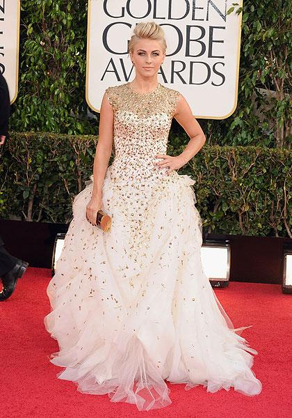 Julianne Hough: It's not the Oscars, Juliane! The 'Rock of Ages' star goes over-the-top in a white tulle gown with golden jewels scattered all over it, giving it a starry quality. But her standout accessories are her earrings which contain 'an actual scarab beetle' and her ear cuff was fashioned from a stick insect. (Photo by Steve Granitz/WireImage)
