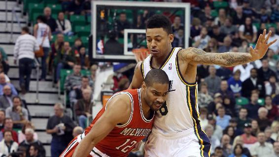 Milwaukee Bucks' Gary Neal (12) drives past Utah Jazz's Diante Garrett, right, in the first half of an NBA basketball game Thursday, Jan. 2, 2014, in Salt Lake City