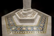 "In this Thursday, Oct. 25 2012 photo, a detail of the Baptismal font from Christ Church, Pomfret, Conn., is photographed while on display at the ""Louis C. Tiffany and the Art of Devotion"" exhibit at the Museum of Biblical Art in New York. (AP Photo/Mary Altaffer)"