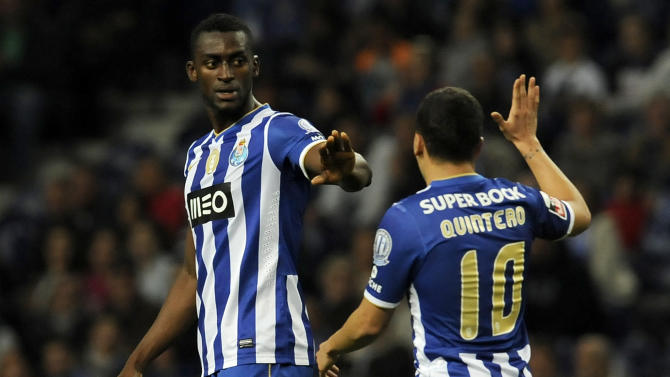 FC Porto's Colombians Jackson Martinez, left, and Juan Quintero celebrate after scoring their team's fourth goal against Arouca in a Portuguese League soccer match at the Dragao stadium, in Porto, Portugal, Sunday, March 9, 2014. Jackson Martinez scored once in Porto's 4-1 victory