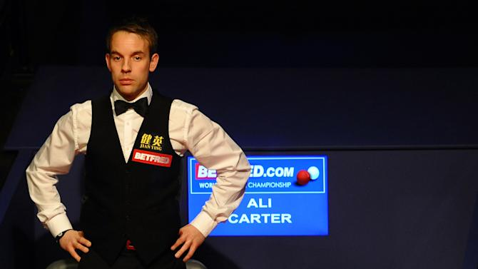 Ali Carter of England watches compatriot  Ronnie O'Sullivan on May 7, 2012 during the third session of the World Championship Snooker final at the Crucible Theater in Sheffield, England. AFP PHOTO/PAUL ELLISPAUL ELLIS/AFP/GettyImages