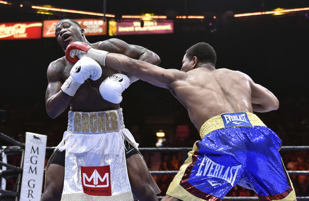 Adrien Broner, left, and Shawn Porter battle during a welterweight fight on Saturday, June 20, 2015, in Las Vegas. Porter won by unanimous decision after a 12-round bout. (AP Photo/David Becker)