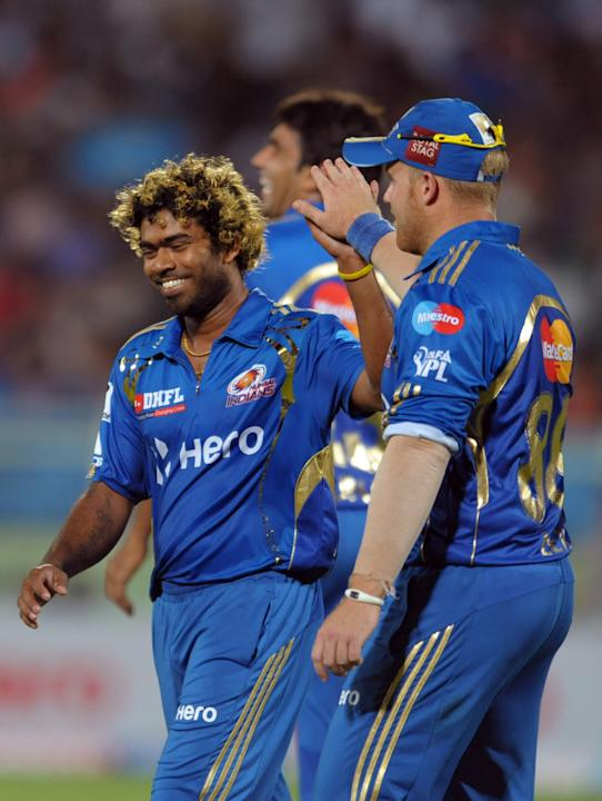 Mumbai Indians bowler Latish Malinga(R) celebrates the wicket of Deccan Chargers Ravi Teja during the IPL Twenty20 cricket match between Deccan Chargers and Mumbai Indians at Dr. Y.S. Rajasekhara Redd