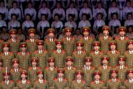 "North Korean performers sing at a theatre during celebrations to mark the 100th birth anniversary of the country's founding leader Kim Il-Sung in Pyongyang on April 16. North Korea demanded Thursday that South Korea apologise for what it called insults during major anniversary festivities, or face a ""sacred war"", as Seoul unveiled a new missile to deter its neighbour"