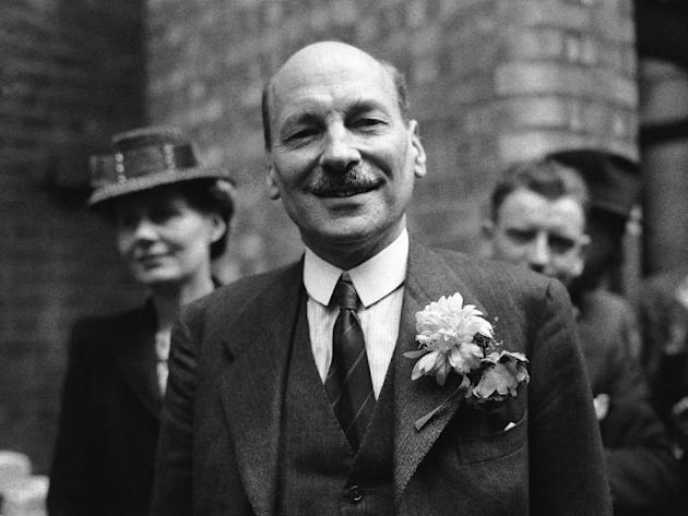 FILE - This is a July 26, 1945  file photo of Labour Party leader Clement Attlee as he smiles at the cheering throngs which gathered at Transport House, in London to celebrate Labour's election vi