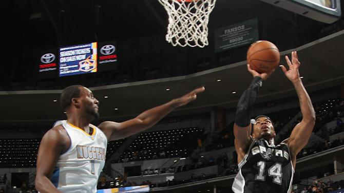 San Antonio Spurs forward Corey Maggette, right, goes up for a shot as Denver Nuggets forward Jordan Hamilton covers in the fourth quarter of the Nuggets' 98-94 victory in an NBA preseason basketball game in Denver on Monday, Oct. 14, 2013