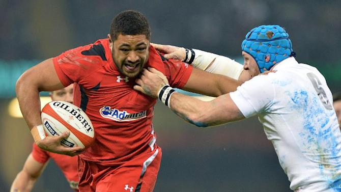 Wales's number Taulupe Faletau (L) runs with the ball during the Six Nations international rugby union match between Wales and England at the Millennium Stadium in Cardiff, south Wales, on February 6, 2015
