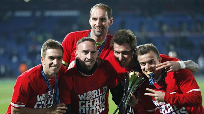 Bayern's Philipp Lahm, Franck Ribery, Tom Starke, Mario Mandzukic and Xherdan Shaqiri, from left, celebrate with the trophy after winning the final of the soccer Club World Cup between FC Bayern Munich and Raja Casablanca in Marrakech, Morocco, Saturday, Dec. 21, 2013