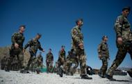 This file photo shows French soldiers gathering during a transition ceremony with Afghan troops at Surobi base, in April. French President Francois Hollande arrived in Kabul on Friday for talks with his Afghan counterpart and to tell French troops why he will pull them out of the war-torn country by the end of 2012 -- two years ahead of NATO allies