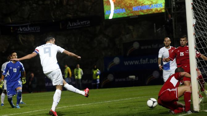 Netherlands' Robin Van Persie scores the second goal against Andorra during their 2014 World Cup qualifying soccer match at Estadi Comunal in Andorra