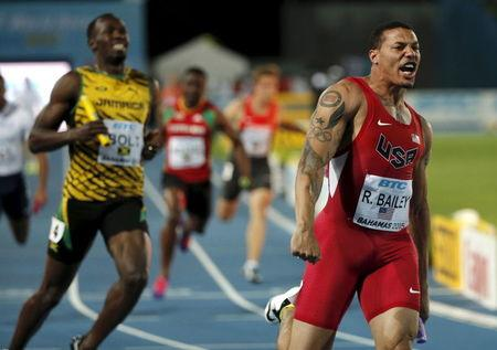 Bailey of the U.S. celebrates as he crosses the finish line ahead of Jamaica's Bolt as the U.S. win the 4x100 meters race at the IAAF World Relays Championships in Nassau