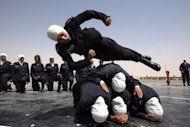 Jordanian policewomen in training at the al-Muwaqr academy. FIFA vice president for Asia Prince Ali of Jordan, who waged a campaign against a ban on the hijab, believes the traditional Islamic headscarf should not prevent Muslim women from joining the Olympics