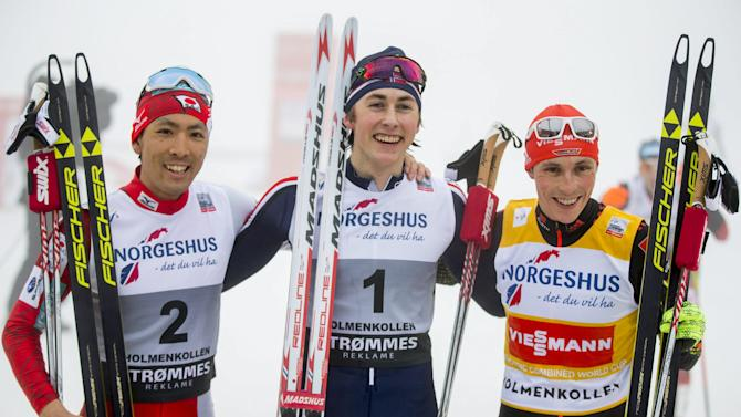 Winner Magnus Riiber of Norway is flanked by second placed Watabe of Japan and third placed Frenzel of Germany after the Men's 10 km Cross Country race FIS Nordic Combined World Cup in Holmenkollen, Oslo