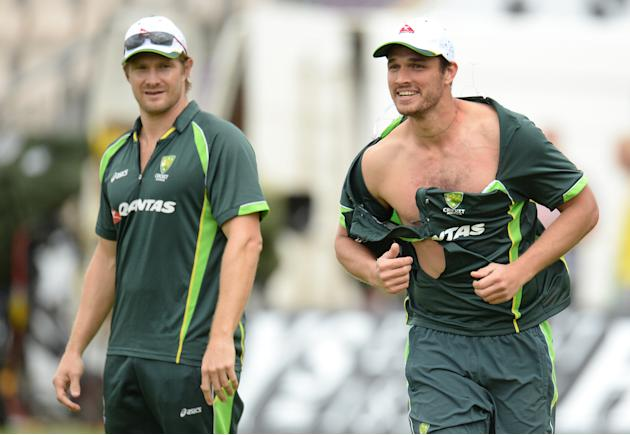 Australia's Nathan Coulter-Nile wears a ripped shirt during a training session during a training session