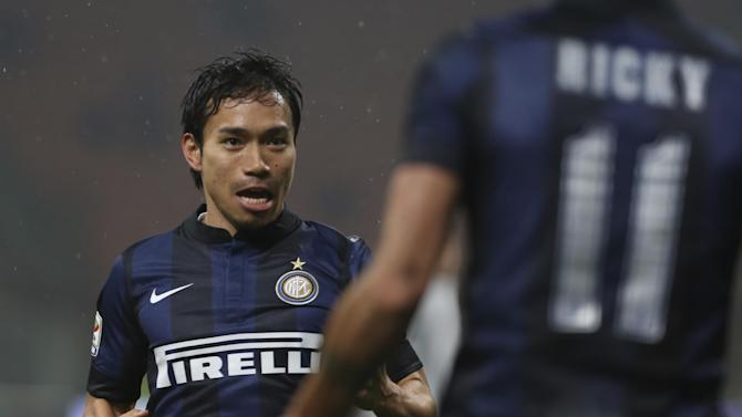 Inter Milan defender Yuto Nagatomo, of Japan, celebrates after scoring during a Serie A soccer match between Inter Milan and Chievo, at the San Siro stadium in Milan, Italy, Monday, Jan.13, 2014