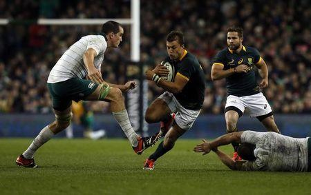 Ireland's Toner challenges South Africa's Pollard during their rugby union international test match in Dublin