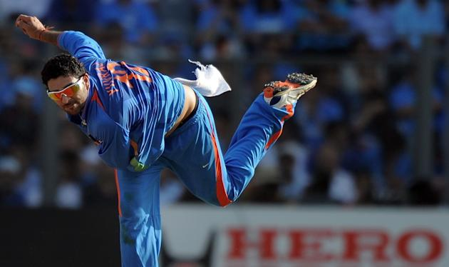 Indian cricketer Yuvraj Singh delivers a