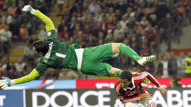 Inter Milan's Handanovic makes a save against AC Milan's Emanuelson during their Italian Serie A soccer match in Milan
