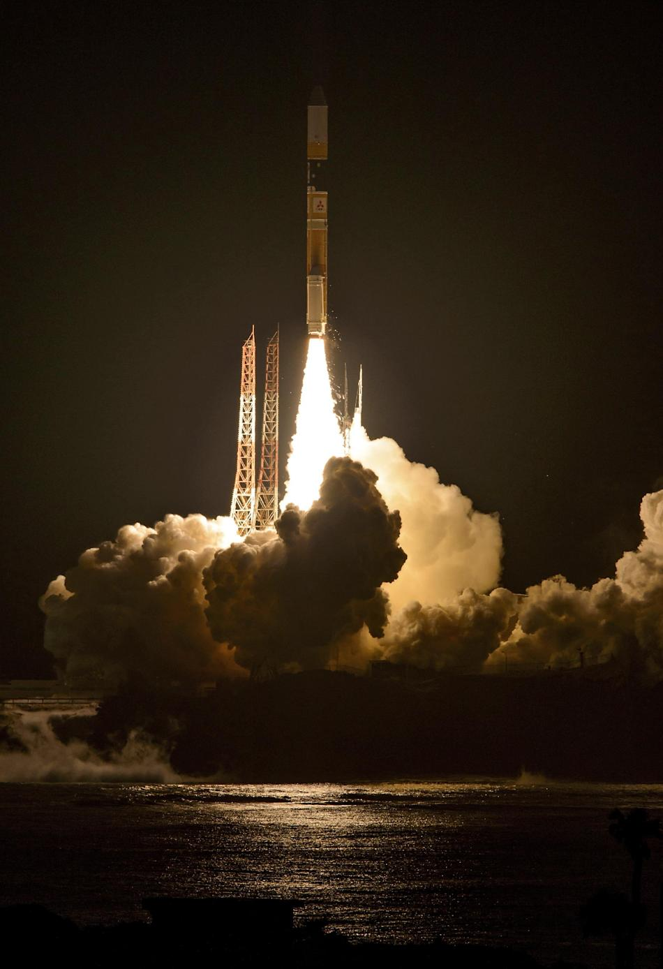 In this image released by NASA, a Japanese H-IIA rocket with the NASA-Japan Aerospace Exploration Agency (JAXA), Global Precipitation Measurement (GPM) Core Observatory onboard takes off from launch p