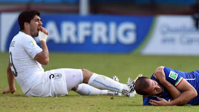 World Cup - 'These things happen' shrugs Suarez, as Uruguay back their icon
