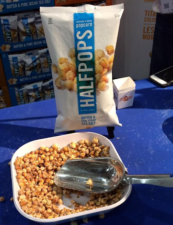 In this June 30, 2015 photo, HalfPops are on display at the 61st annual Fancy Food Show in New York. To many people, the best part of eating popcorn is the half-popped kernels sitting at the bottom of