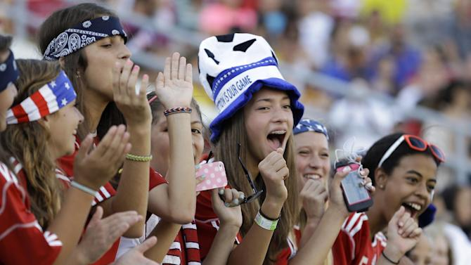Fans cheer on the United States Women's national team against Brazil during the first half of an international friendly soccer match in Orlando, Fla., Sunday, Nov. 10, 2013
