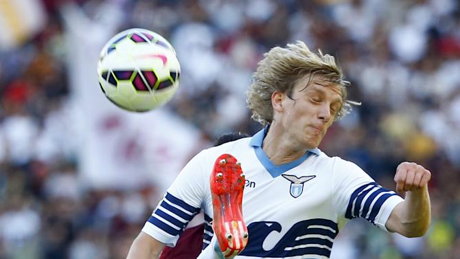 AS Roma's Iturbe challenges Lazio's Basta during their Serie A soccer match at the Olympic stadium in Rome