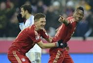 Bayern Munich's midfielder Bastian Schweinsteiger (L) and his teammate David Alaba celebrate after the third goal for Munich during their German first division Bundesliga football match against Schalke 04 in Munich, southern Germany, on February 9, 2013. Bayern Munich extend their lead at the top of the Bundesliga to 15 points following their 4-0 rout of Schalke 04