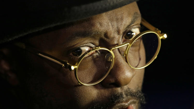 Will I. Am is interviewed during The Inaugural Ball at the Washignton convention center during the 57th Presidential Inauguration in Washington, Monday, Jan. 21, 2013. (AP Photo/Paul Sancya)